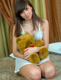 A hot teenage brunette with blue eyes rubbing her cooch