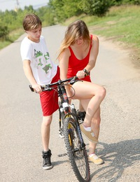 Sexy teenager on a bike nailed outside near a dirt road